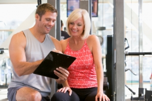trainer and woman at gym