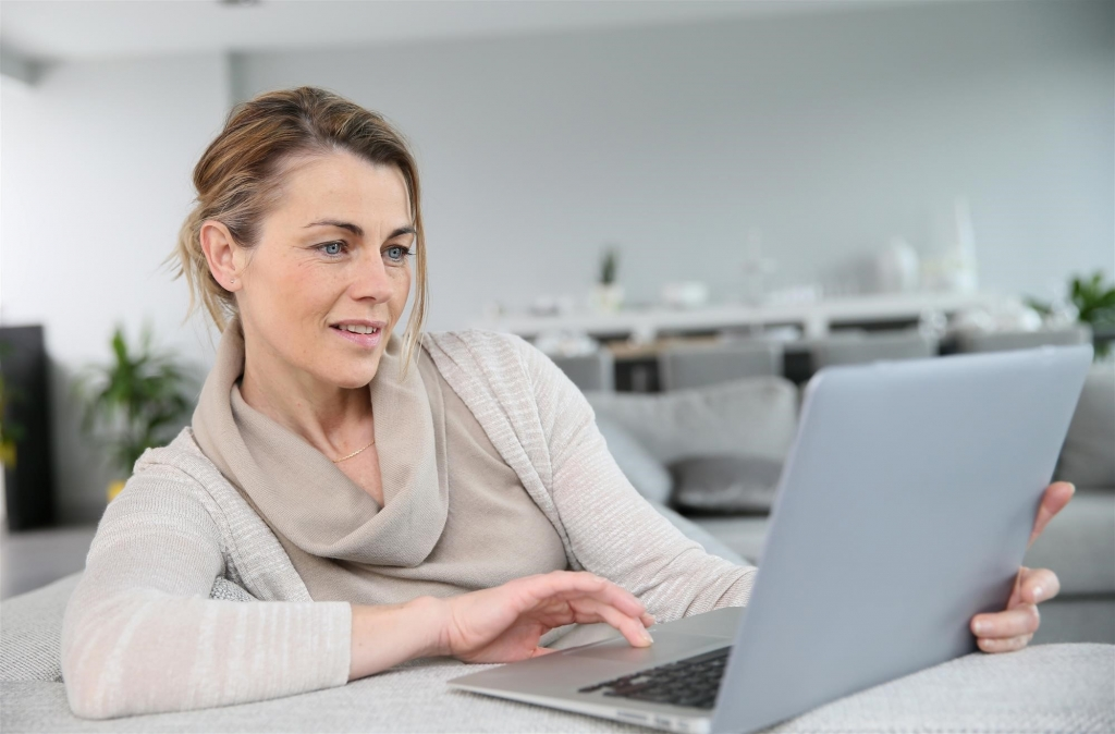 woman doing research on ui on laptop