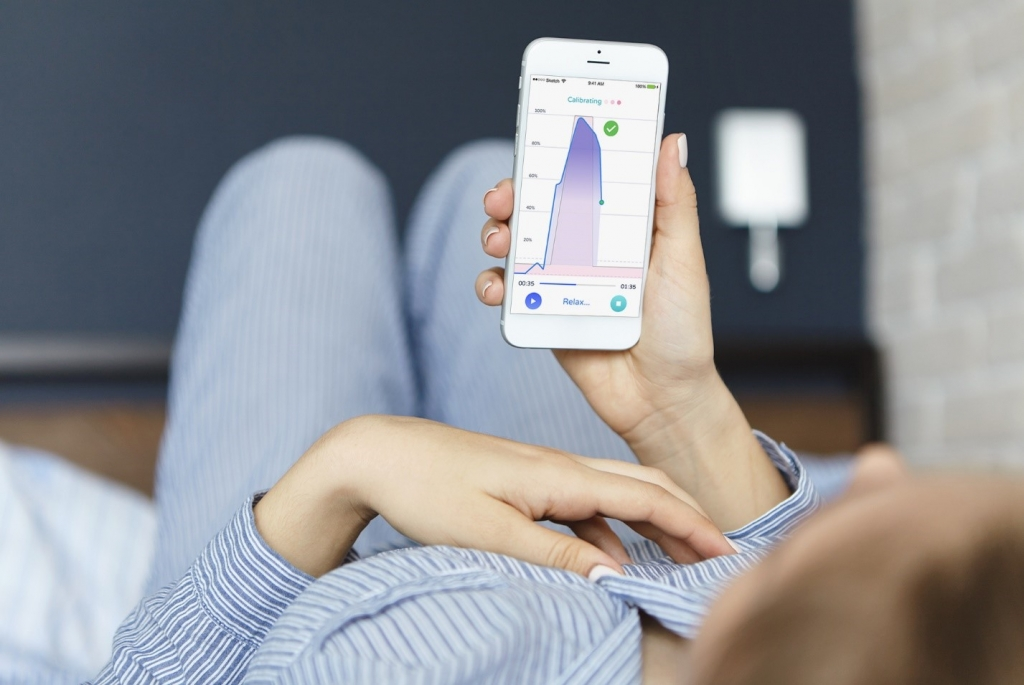 woman using pericoach app