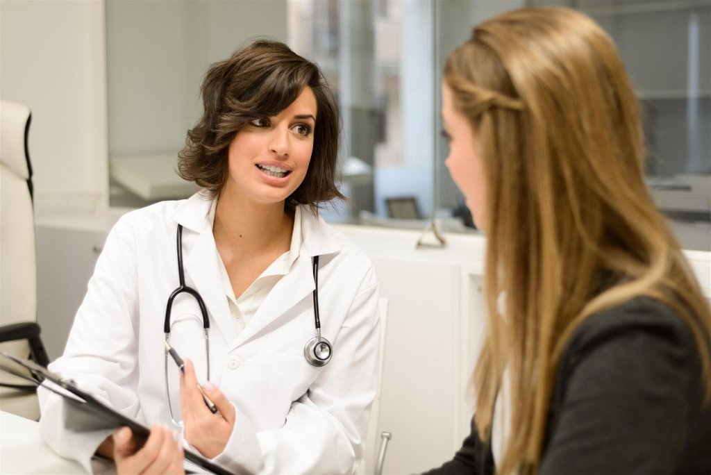 woman speaking with a pelvic floor specialist